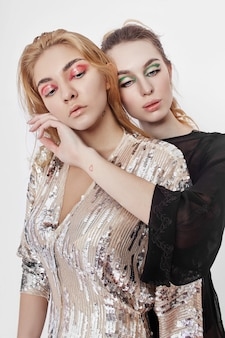 Beauty fashion two woman with bright makeup on her face