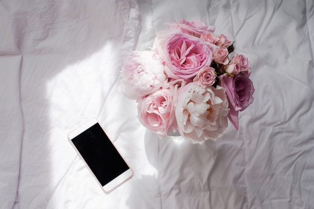 Beauty flat lay with phone and flower