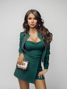 Beauty girl in fashionable green overall and heels.
