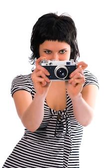 흰색 배경에 사진 카메라와 함께 선원의 조끼에 미녀 사진 작가