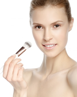 Beauty girl with makeup brush. natural make-up. nude make-up. beautiful face.