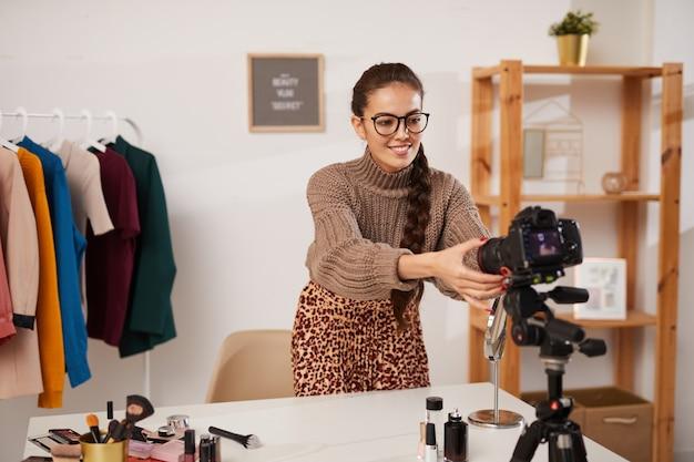 Beauty guru setting up camera