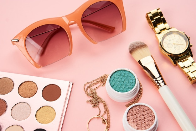 Beauty layout with cosmetics and jewelry