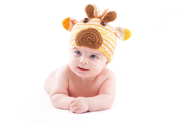Beauty little boy in white diaper and deer hat