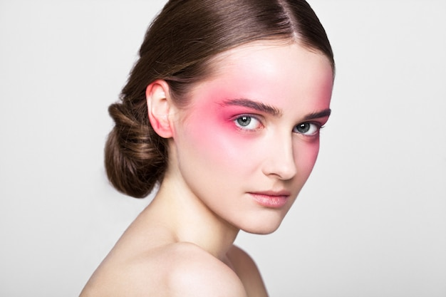 Beauty makeup pink eyes and lips fashion model beautiful girl on grey background
