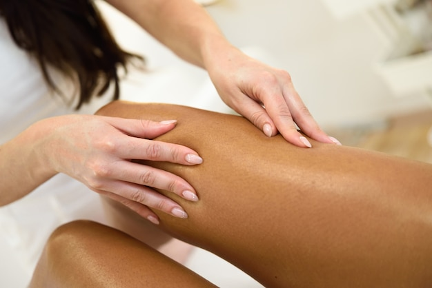 Beauty massage in the leg in a beauty salon.