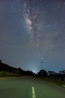 The beauty of the milkyway on the road at nigt