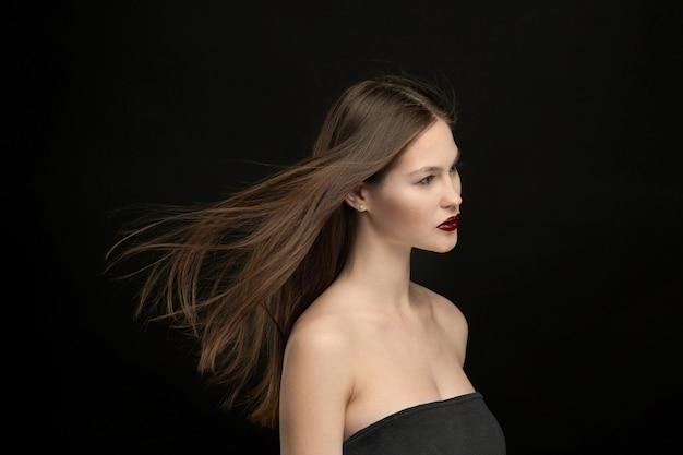 Beauty model on the black background
