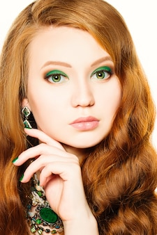 Beauty model girl with makeup and red hair