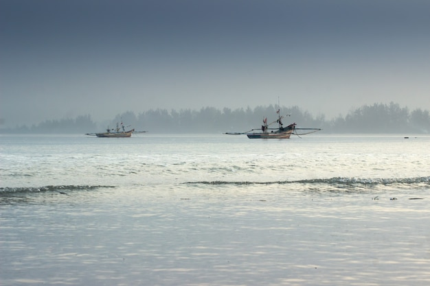 Beauty morning light with shake boat in ocean. bengkulu, indonesia