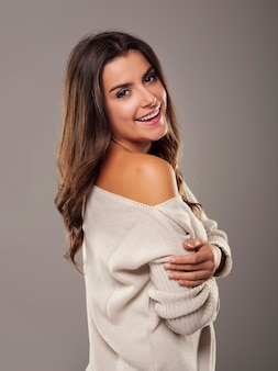 Beauty and natural woman wearing oversized sweater