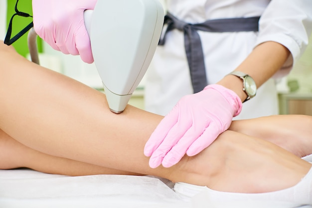 Beauty parlor, laser hair removal, doctor and patient