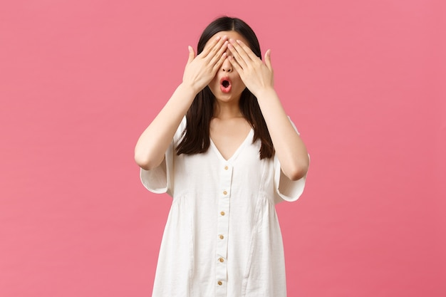 Beauty, people emotions and summer leisure and vacation concept. cute and excited asian birthday girl celebrating at party, waiting for surprise with shut eyes, standing blindfolded amazed.