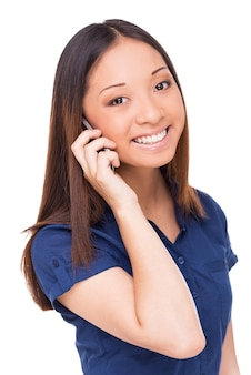 Beauty on the phone. cheerful young asian woman talking on the mobile phone and looking at camera