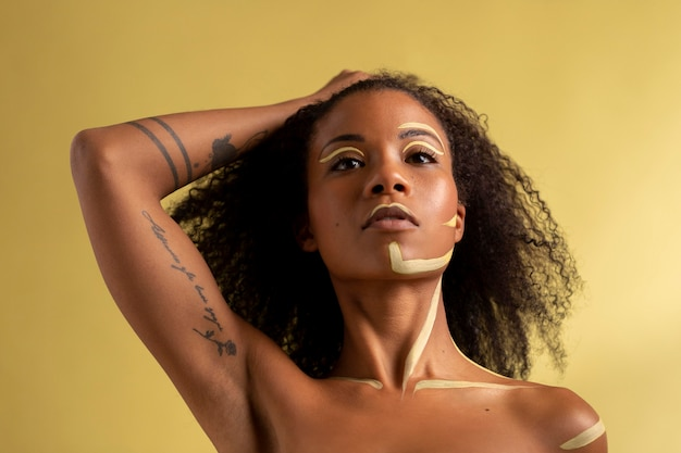 Beauty portrait of afro woman with ethnic makeup