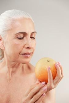Beauty portrait of an attractive half naked elderly woman