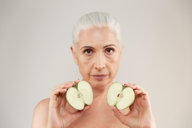 Beauty portrait of an attractive half naked elderly woman