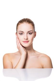 Beauty portrait. beautiful spa woman touching her face. perfect fresh skin. pure beauty model girl.