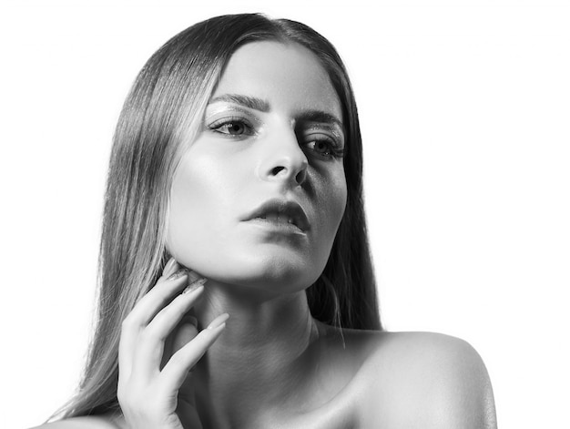 Beauty portrait of beautiful young woman with bright make-up. the black and white photo