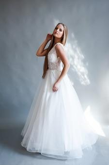 Beauty portrait of blonde bride wearing fashion wedding dress