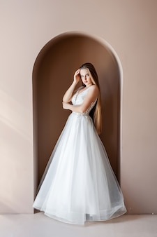 Beauty portrait of bride wearing fashion wedding dress with feathers with luxury delight makeup