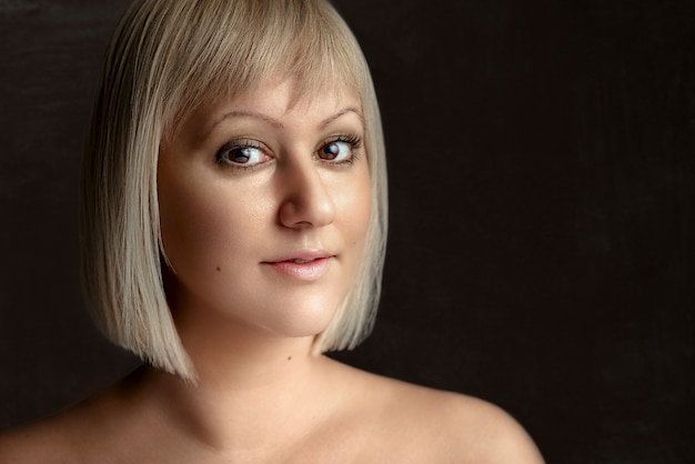 Beauty portrait closeup portrait studio shot of girl over on gray background highend retouch
