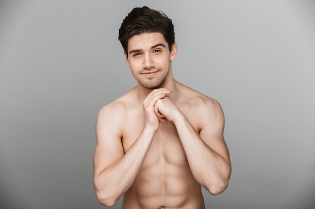 Beauty portrait of fit half naked smiling young man
