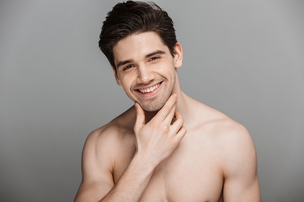 Beauty portrait of half naked laughing young man