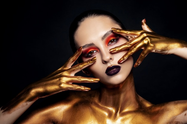Beauty portrait of model with golden make-up
