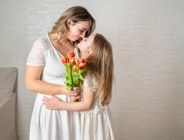 Beauty portrait of mother and daughter on white