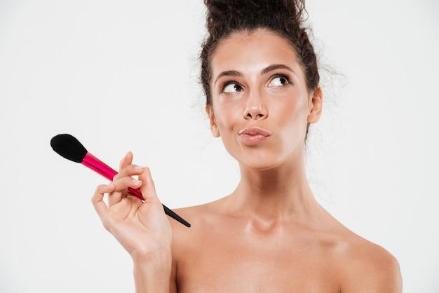 Beauty portrait of a pensive brunette woman