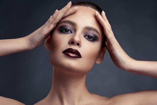 Beauty portrait of woman with smokey eyes make-up