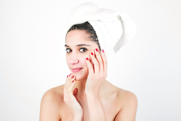 Beauty portrait of a woman with towel wrapped around her head