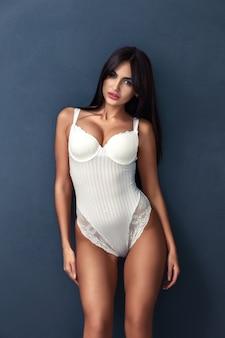 Beauty portrait of young brunette women in sexy white underwear