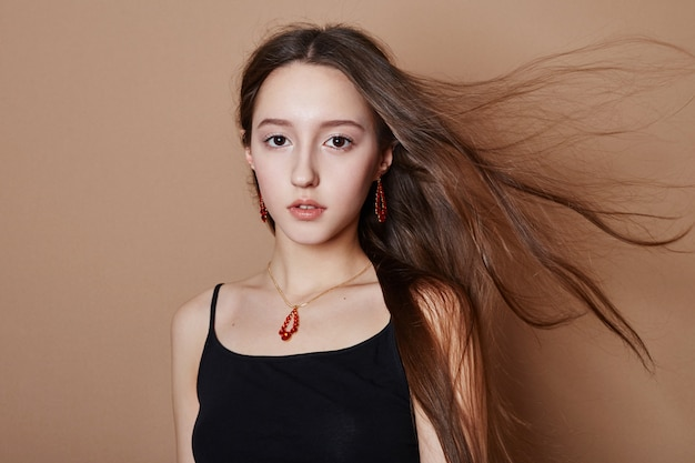Beauty portrait of a young girl with long hair
