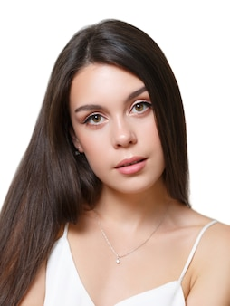 Beauty portrait of a young woman brunette girl isolated on a white background