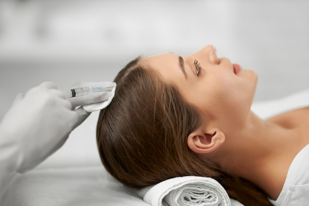 Beauty procedure for growth hair in professional salon