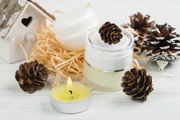 Beauty products and pine cones