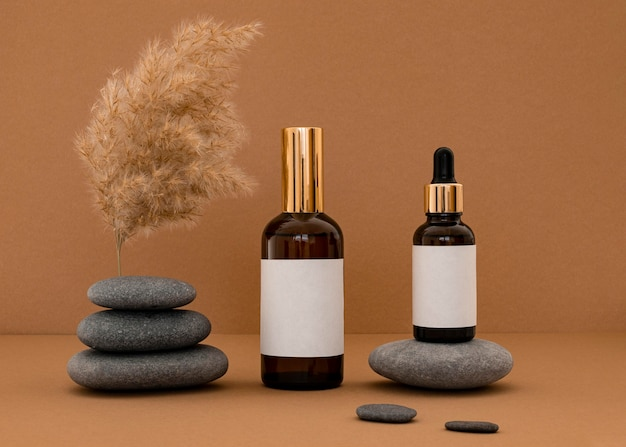 Beauty products in recipients assortment on grey stones