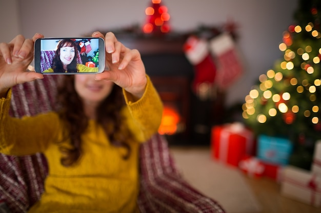 Beauty redhead taking a selfie at christmas