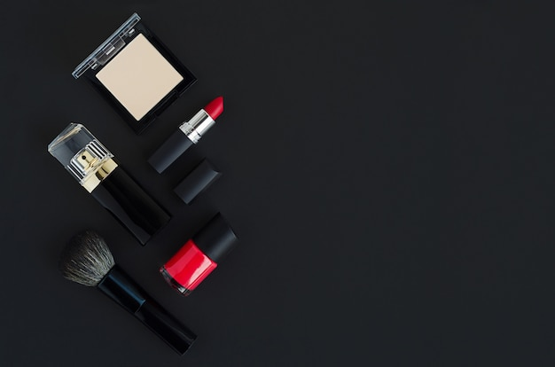 Beauty sale. luxury branded decorative cosmetics product, perfume, make up on dark background. black friday. gifts, present, discount for holidays.