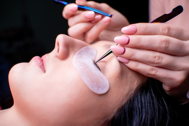 Beauty salon, eyelash extension procedure close up