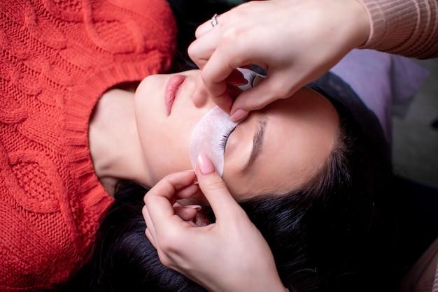 Beauty salon, eyelash extension procedure close up