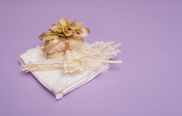 Beauty set with soap on a violet background