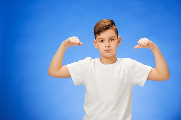 Beauty smiling sport child boy showing his biceps