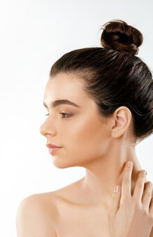 Beauty and spa concept. beautiful young woman with clean fresh skin touch own face.facial treatment.