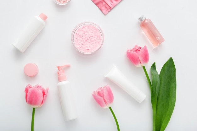 Beauty spa medical skincare make up bath products. cosmetic bottles, tubes, dispenser, dropper, cream packaging. cosmetics spa branding mock-up for bath products background top view flat lay.
