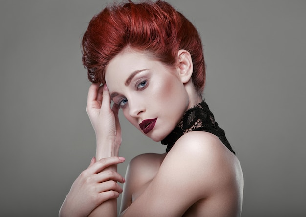 Beauty stylish redhead woman with necklace jewelry in studio