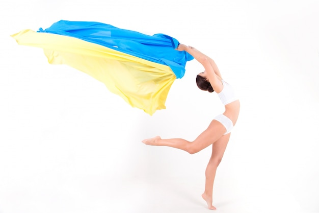 Beauty ukrainian woman with blue and yellow fabric as symbol of ukraine flag