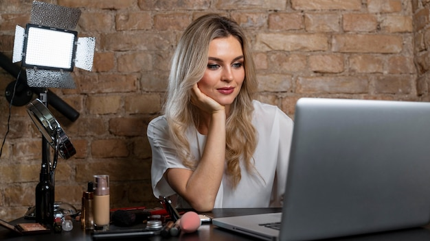 Beauty vlogger making a video for her online followers